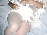 Busty wife shows off in bed in her white lingerie