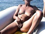 Mature woman loves boating and masturbating at sea