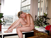 Mature wife nude on high rise apartment window sill exhibition