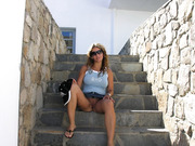 Milf on holiday in the sun flashing her tits and pussy in public places