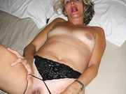 Mature blonde spreading her cunt pussy and playing with sex toys