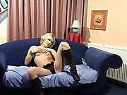 Hot busty blonde masturbates on the sofa for webcam admirers