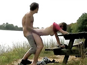 Hot ass brunette gets rammed doggy style by the lake